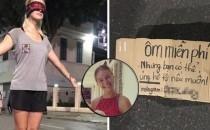 Cô gái ngoại quốc xinh đẹp bịt mắt, dang tay 'free hugs' gây náo loạn phố đi bộ Hà Nội