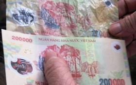 Không thể nhận biết tiền giả qua chữ cái đầu số xêri