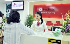 Áp lực xử lý triệt để nợ xấu ngân hàng